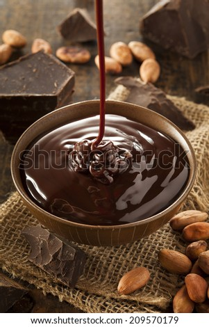 Sweet Dark Chocolate Sauce in a Bowl - stock photo