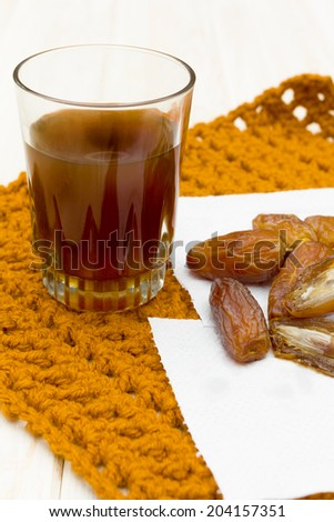 Sweet dates and tea  - stock photo