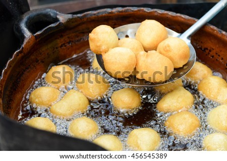 Sweet deep fried bunuelos - local donuts at the food market in Quetzaltenango, Guatemala. Shallow depth of field.
