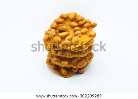 Sweet deep fried peanut cookie on white background - stock photo