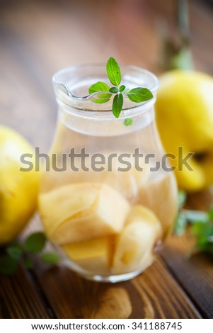 sweet delicious compote of quince in the decanter - stock photo