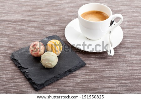 sweet delicious truffle pralines chocolate and hot espresso coffee objects food assortement - stock photo