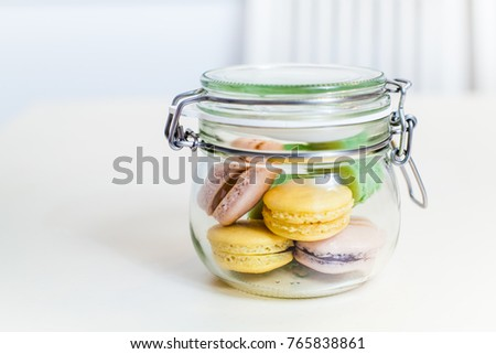Sweet dessert french macarons in jar, handmade food , colourful delicious macaroon