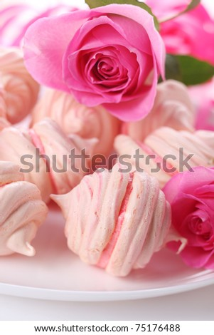 Sweet dessert- pink meringue with cream and rose - stock photo