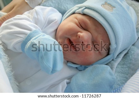 Sweet dream after childbirth, newborn baby in hospital. - stock photo