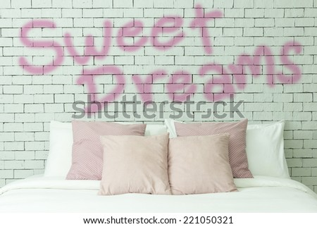 Sweet dreams concept on bricks wall background - stock photo