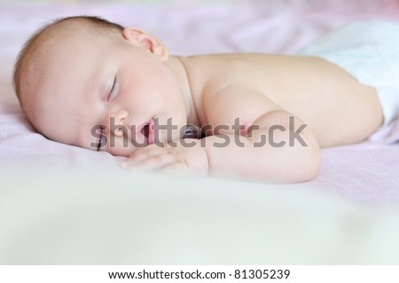 sweet dreams of baby girl in soft focus - stock photo