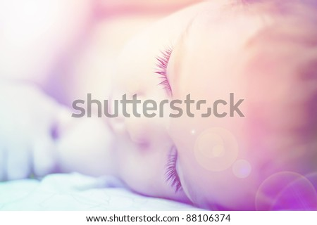 sweet dreams of beautiful baby with long eyelashes - stock photo
