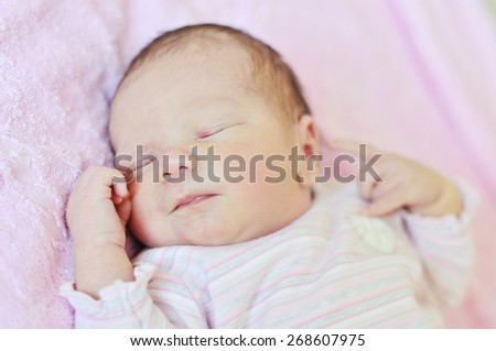 sweet dreams of newborn girl in soft selective focus - stock photo