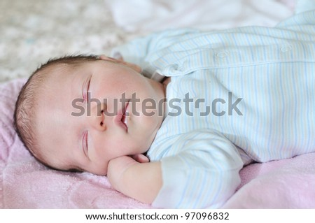 sweet dreams of newborn in soft focus - stock photo