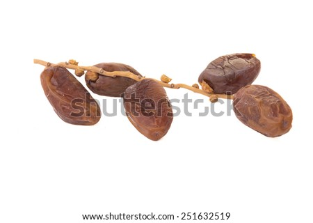 Sweet dried Date Palm fruit on White isolate background