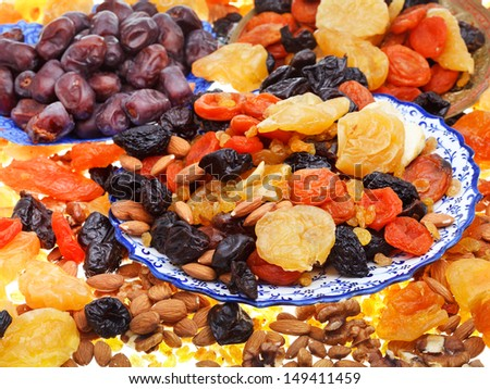 sweet dried fruits on asian plates