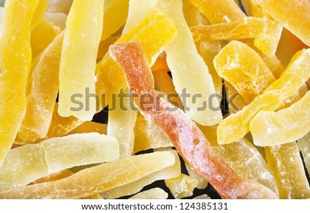 Sweet dried papaya fruit bars background - stock photo