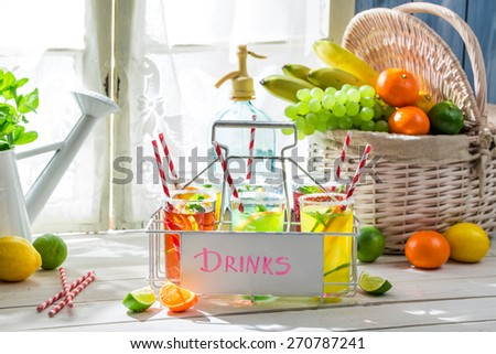 Sweet drink with straw and fruits
