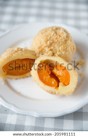 Sweet dumplings filled with apricots - stock photo