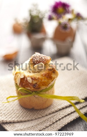 Sweet Easter bread with egg decoration and flowers - stock photo