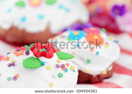 Sweet easter cake and eggs on the table - stock photo