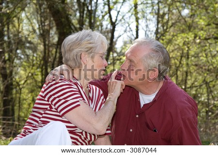 Sweet elderly couple outdoors on a hot summerday - stock photo
