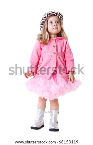 sweet fashionable girl  in pink pettiskirt, coat and zebra hat - stock photo