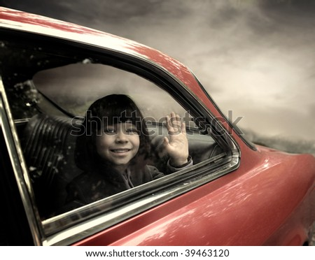sweet female child looking trough car window - stock photo