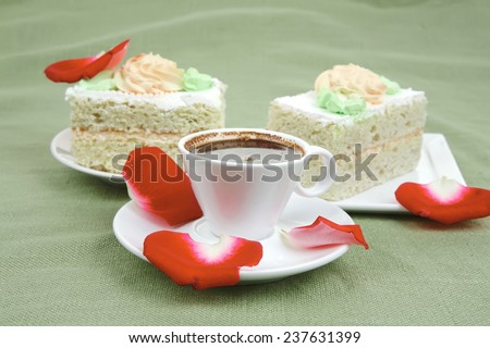 sweet food : milked cream cake with roses and hot black coffee cup - stock photo