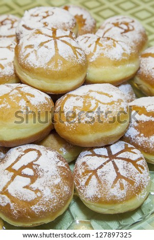 Sweet fresh baked donuts sprinkled with powdered sugar - stock photo