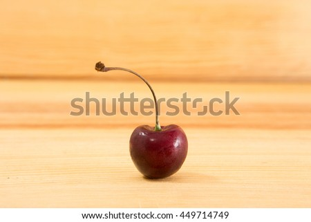 Sweet fresh cherries on  wooden table background.Fresh healthy fruit.