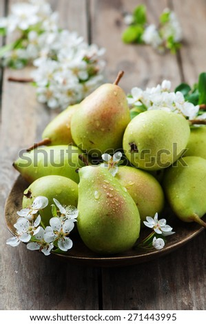 Sweet fresh pears on the wooden table, selective focus - stock photo