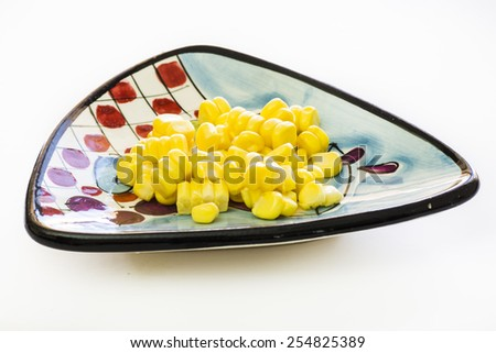 Sweet, fresh, raw, ripe, juicy kernels of corn on the plate. - stock photo