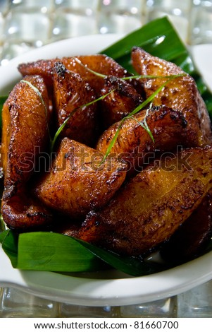 sweet fried plantains over banana leaves - stock photo