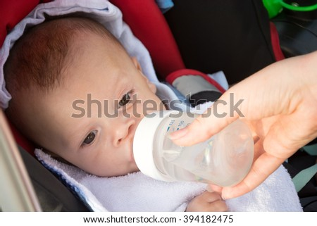 sweet funny baby drinking water - stock photo