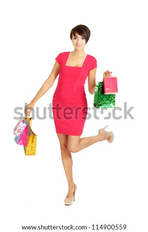 Sweet girl in a coral dress successfully acquired gifts - stock photo