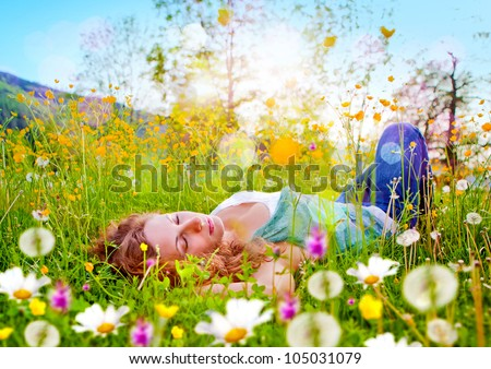 sweet girl in a meadow full of dandelions - stock photo