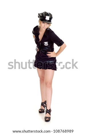 Sweet girl in a uniform of  police officer on a white background - stock photo