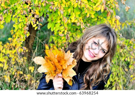 sweet girl in fall forest with leaves