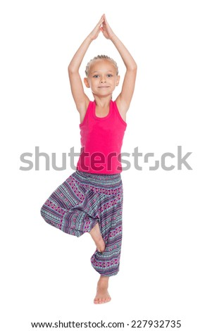 Sweet girl in great shape practicing yoga. Girl is six years old - stock photo