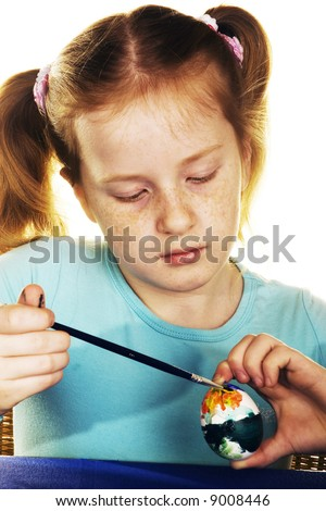 sweet girl is painting easter eggs - stock photo