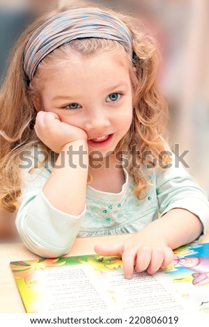 Sweet girl with a book - stock photo