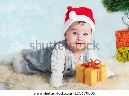 Sweet girl with a gift in a red cap - stock photo