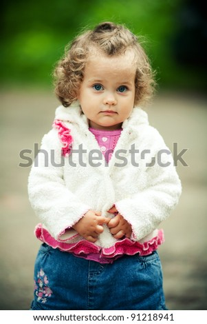 sweet girl with curls  outside - stock photo