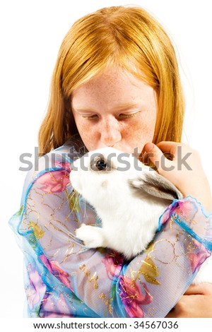 Sweet girl with rabbit isolated on white - stock photo