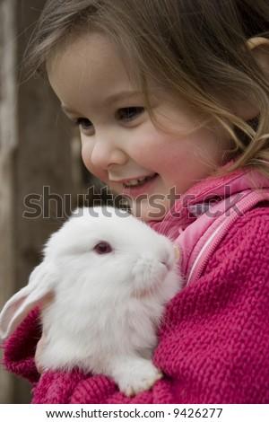 Sweet girl with rabit - stock photo