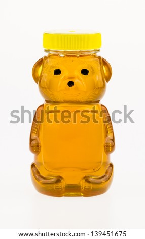 Sweet golden honey in a plastic bear shaped container.