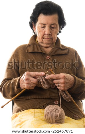 sweet grandmother old woman knitting  isolated on white - stock photo
