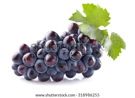 Sweet grapes with leaves - stock photo