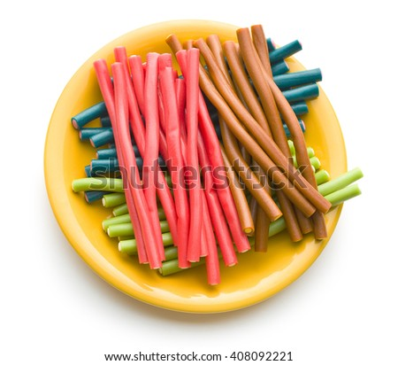 Sweet gummy sticks with different flavors. Tasty fruity candies on white background. - stock photo