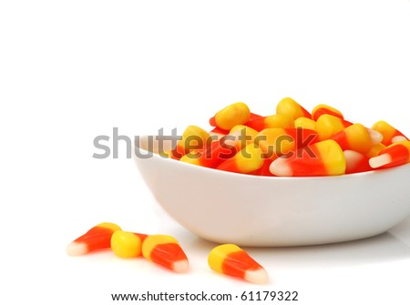 Sweet Halloween Candy Corn in a White Bowl - stock photo