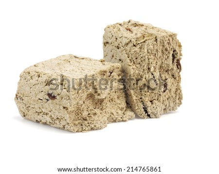 Sweet halva with raisins on a white background - stock photo