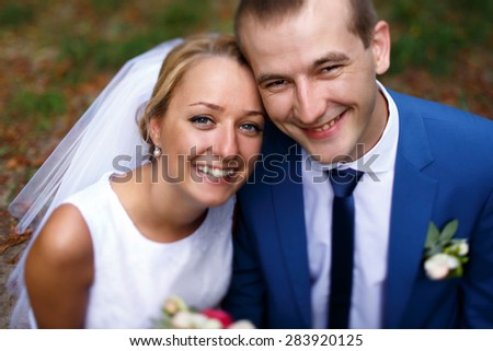 sweet happy bride and groom on their wedding day