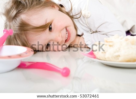 sweet happy little girl eating - stock photo